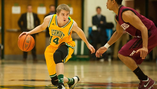 Catamounts guard Cam Ward (14) looks to pass the ball during the men's basketball game between the Harvard Crimson and the Vermont Catamounts at Patrick Gym on Saturday night December 6, 2014 in Burlington, Vermont. (BRIAN JENKINS, for the Free Press)