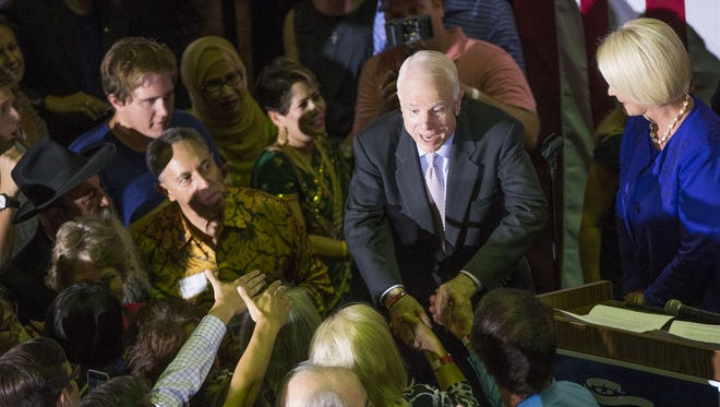 U.S. Sen. John McCain shakes hands after speaking to his supporters at his campaign headquarters in Phoenix on Aug. 30, 2016. McCain faced competition from Kelli Ward for his Senate seat in the Arizona Republican primary.