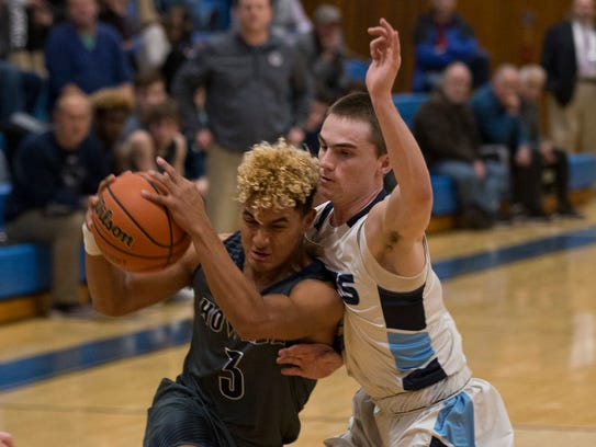 Howell's Eddie Morales tries driving into the basket