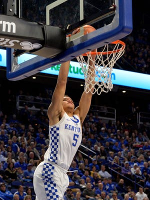 Kentucky Wildcats forward Kevin Knox (5) goes in for a dunk during the first half of their game against Thomas More, Friday, Oct. 27, 2017, in Lexington, Kentucky.