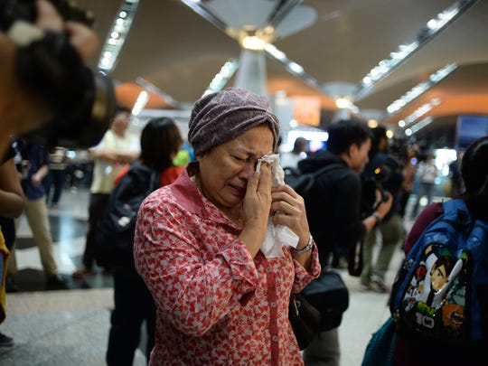 A woman reacts to news regarding a Malaysia Airlines plane that crashed in eastern Ukraine at Kuala Lumpur International Airport in Sepang, Malaysia.