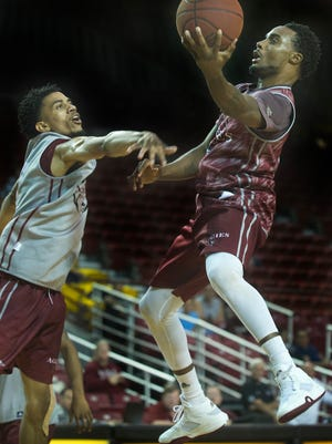 New Mexico State's Ian Baker, right, is one of two returning starters for the Aggies this season. Baker is also a preseason first-team All-Western Athletic Conference selection.