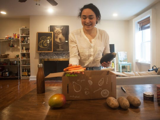 Emily Coch sorts vegetables at her home in Philadelphia