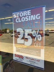 A sign posted at the Save-A-Lot store in St. Cloud