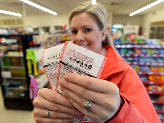 Andrea Hirose shows off her Powerball lottery tickets