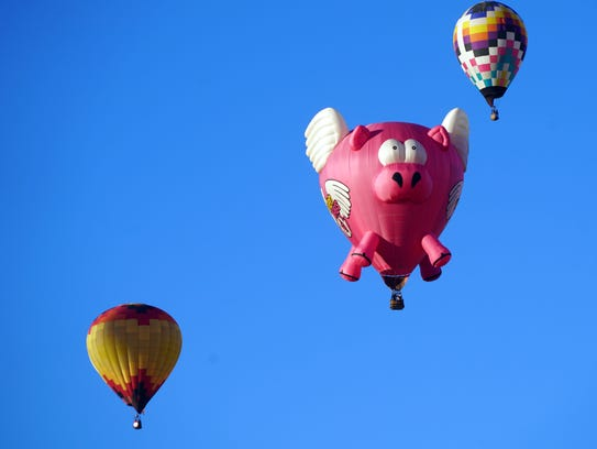 Ham-Let, a 100-foot-tall special shape balloon cruises