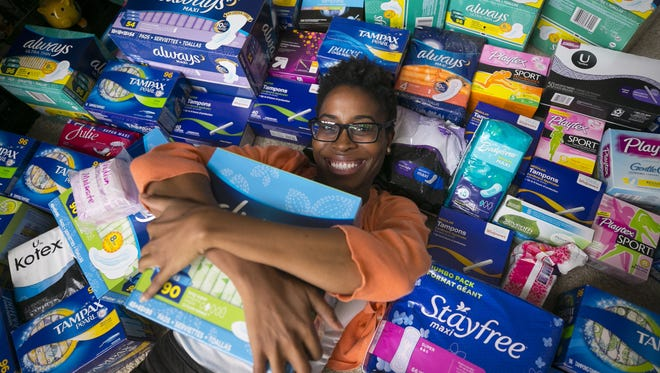 """Demetra Presley started a non-profit called """"Go With the Flow"""" to get feminine products to low-income and homeless girls. Presley is seen with these products at her Phoenix apartment."""