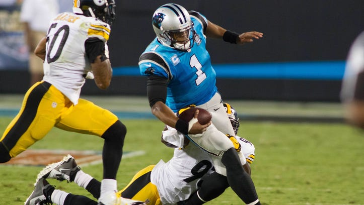 Carolina Panthers quarterback Cam Newton (1) carries the ball as Pittsburgh Steelers outside linebacker Jason Worilds (93) defends during the second quarter at Bank of America Stadium.