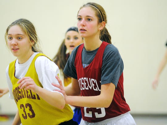 Roosevelt's Tagyn Larson (right) participates in a drill during practice in her senior season with Roosevelt.
