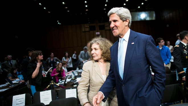 Teresa Heinz Kerry stands with her husband, Secretary of State John Kerry, during a Capitol Hill hearing on Syria in September.