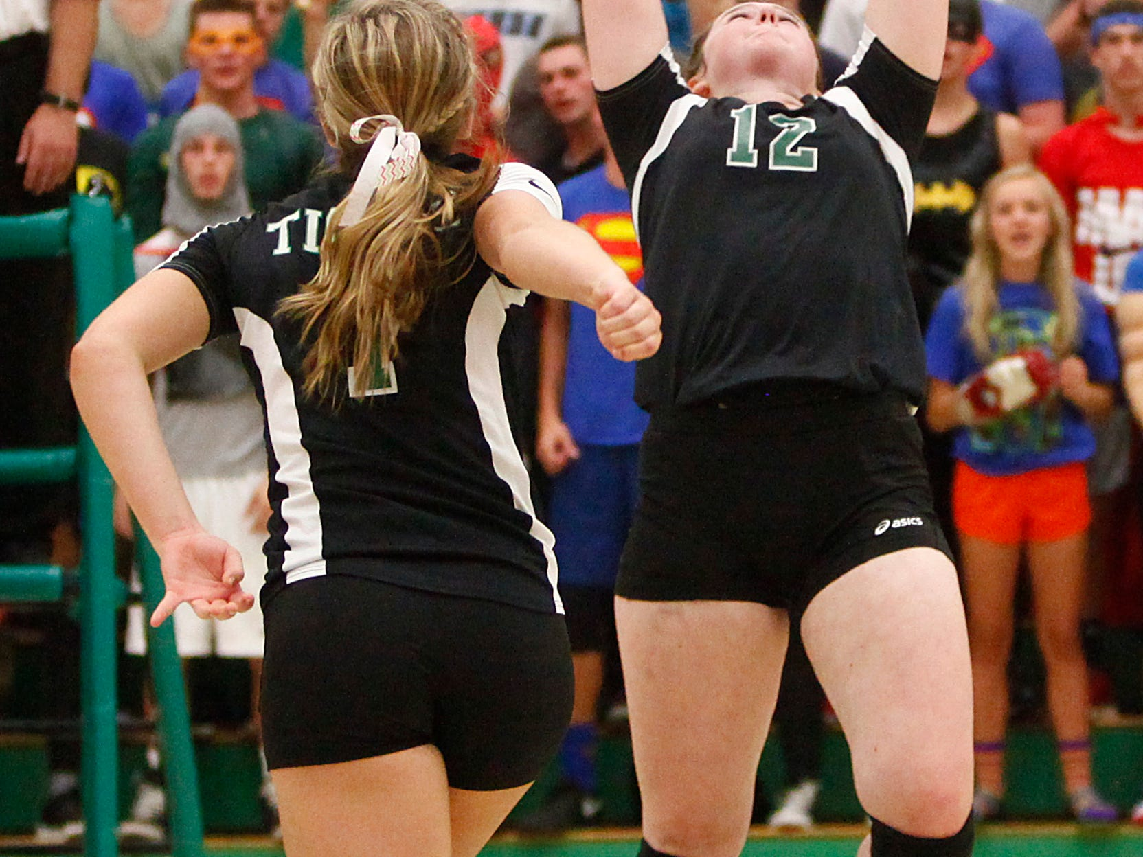 Yorktown's Mimi Arrington sets the ball during the opening set against Central on Thursday. Yorktown won the five-set match 3-2.