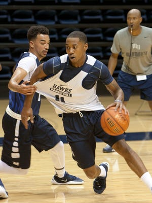 10/5/15 - Monmouth's  Je'lon Hornbeak (right) guarded by Micah Seaborn during Monmouth University men's basketball practice.