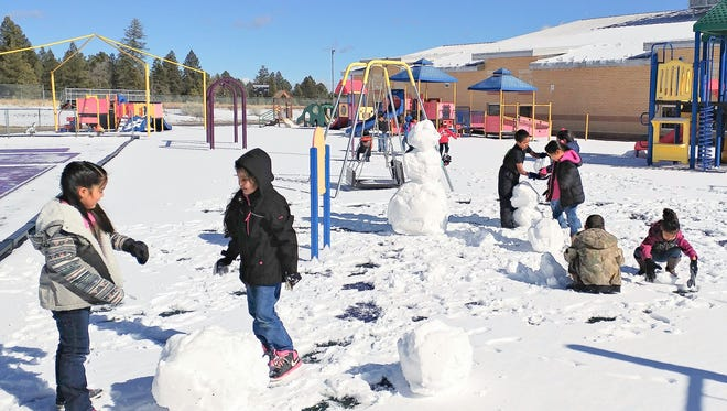 The storm was brief but left enough snow behind for fist grade fun at the Mescalero School.