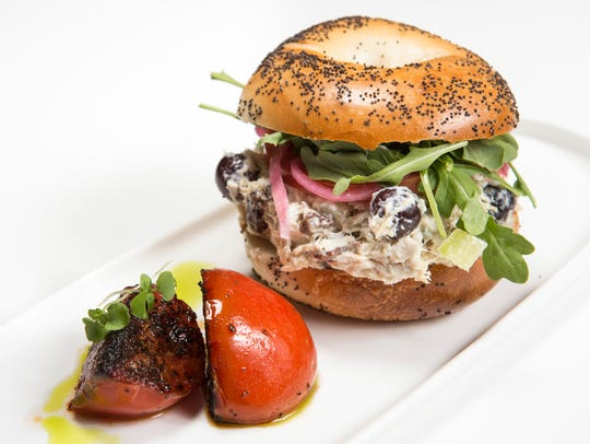Waldorf chicken salad on a poppy seed bagel at Proper