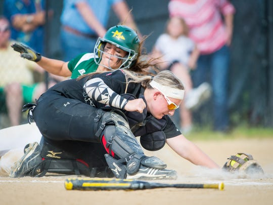 Mardela shortstop Sydney Goertzen (13) slides safely into home for a 4-0 lead against Saint Michael's in the 1A East Region Finals at Saint Michael's High School on Friday, May 20.