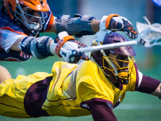 Gettysburg attack Ivan Morris (32) and Salisbury University midfield Christian Ottenritter (1) dive after a shot in the NCAA Division 3 Men's Lacrosse tournament on Sunday, May 22 at Sea Gull Stadium in Salisbury.