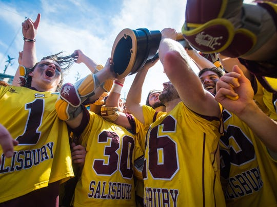 Salisbury University goalkeeper Colin Reymann (26) raises the trophy after taking the 14-13 win against Tufts University in the NCAA Divison 3 Finals on Sunday, May 29 at Lincoln Financial Field in Philadelphia, PA.