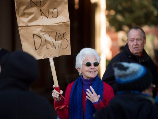 Martha Stephens protests outside of Sen. Lamar Alexander's office on Monday, January 30, 2017 to protest the nomination of Betsy DeVos as Secretary of Education.