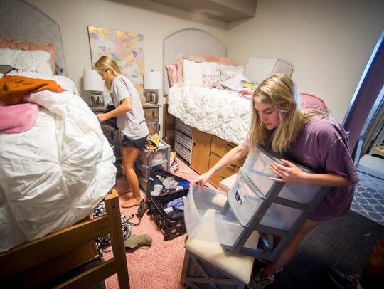 Roommates Anna Kathryn Horn, left, and Alex Horn, right,