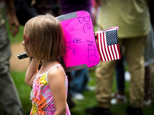 A child holds a hand-lettered sign at the Kindness Rally in Krutch Park in downtown Knoxville on Saturday, Aug. 26, 2017.