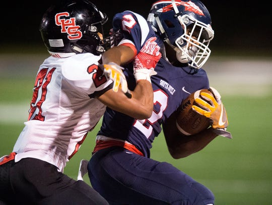 South-Doyle's Elijah Young is grabbed by Central's