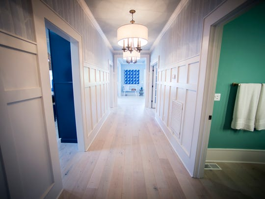 The wider renovated hallway gleams with light finished