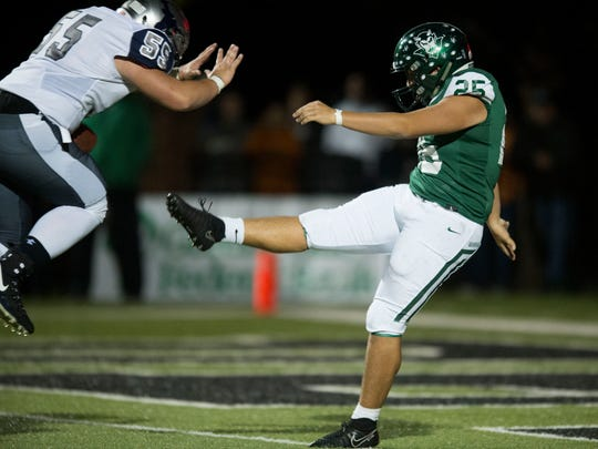 Anderson County's Trey Noe blocks a punt by Greeneville's