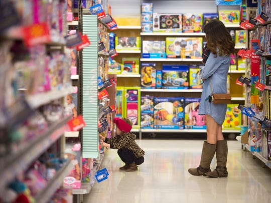 Victoria Morgan, right, watches her daughter Annagayle look at toys at the Walmart on Walbrook Drive in Knoxville on Tuesday, Nov. 21, 2017.