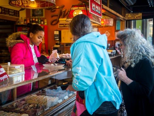 Customers sample fudge at the Fudge Shoppe in the Smokies