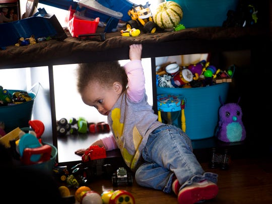 Violet plays with her toys at home on Monday, Nov. 27, 2017.