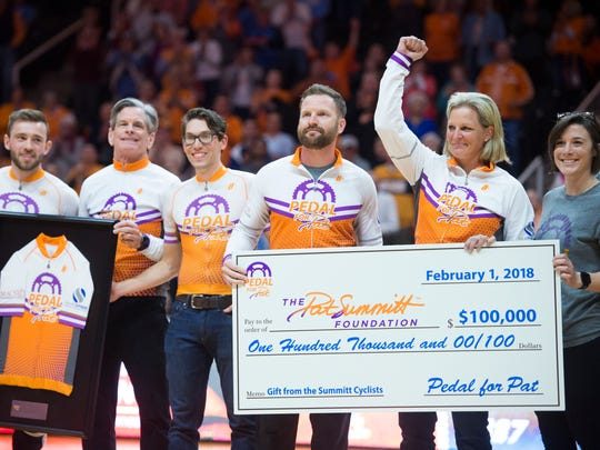 The Summitt Cyclists raised and donated $100,000 to the Pat Summitt Foundation. Raising her arm in celebration is former Lady Vol Michelle Marciniak.