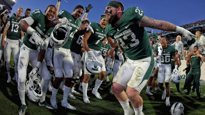 Michigan State linebacker and captain Chris Frey (23) celebrates a win over Iowa Saturday with his teammates.