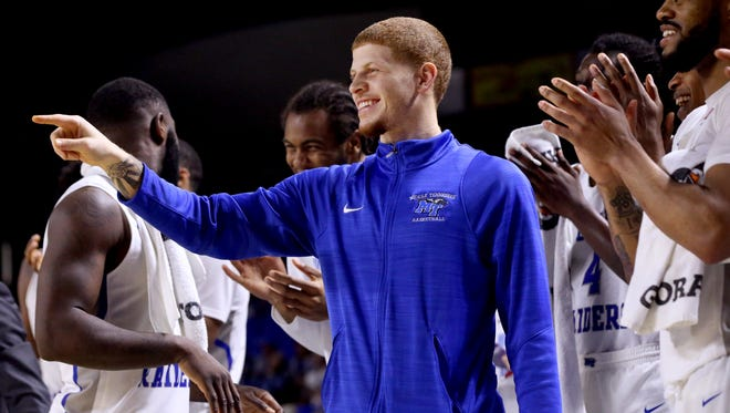 MTSU's Tyrik Dixon (0), who was injured in an earlier game, reacts from the bench near the end of the UAB game on Saturday, Feb. 24, 2018, at MTSU.