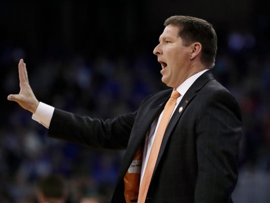 Clemson head coach Brad Brownell is seen on the sidelines during the first half of a regional semifinal game against Kansas in the NCAA men's college basketball tournament Friday, March 23, 2018, in Omaha, Neb. (AP Photo/Nati Harnik)