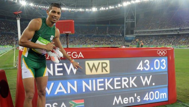 Wayde Van Niekerk of South Africa smashes the 400 world record.