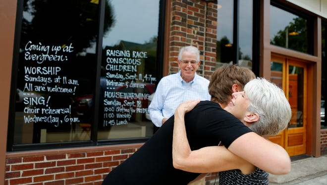 September 18, 2016 - Evergreen Presbyterian Church pastor Rev. Lucy Waechter Webb hugs Fran Shannon outside the church's new home prior to Sunday service celebrating the history of the church. Evergreen sold their former home, along with the 9.7 acres of land under it to Rhodes College and has settled into a humble 6,500 square foot building on Overton Park. (Mike Brown/The Commercial Appeal) (Mike Brown/The Commercial Appeal)