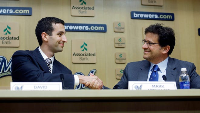David Stearns shakes hands with Milwaukee Brewers owner Mark Attanasio during a news conference in Milwaukee. Stearns was introduced as the Brewers' new general manager.