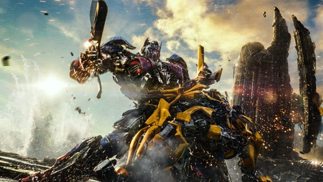 Autobot pals Optimus Prime and Bumblebee tussle in 'Transformers: The Last Knight.'