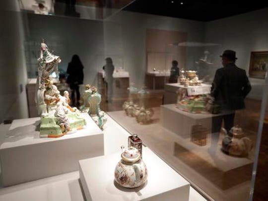 "In a photo from Nov. 16, 2016 tea pots and accessories are displayed at the Detroit Institute of Arts in Detroit. The ""Bitter