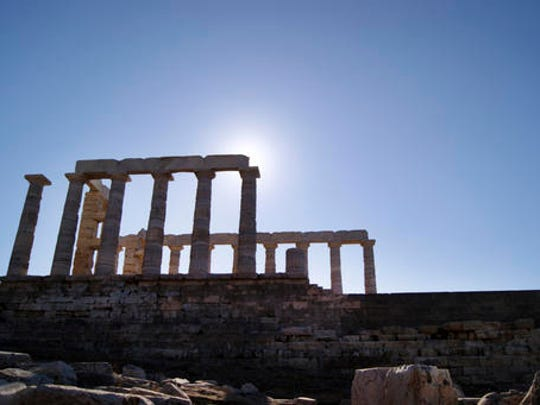 In this Dec. 12, 2016 photo, the Temple of Poseidon, an ancient hilltop structure on the southern peninsula of Sounion dedicated to the god of the sea is shown. For travelers with more than beaches on their minds, there's plenty of upside to a brief winter visit to Athens that avoids the crowds and heat of summer.