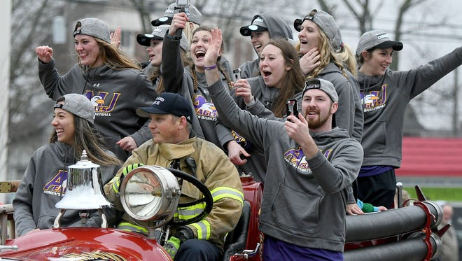 The undefeated NCAA Division II Women's Basketball National Champion Ashland Eagles celebrate while riding on an antique fire truck during a parade in their honor on Tuesday in Ashland.