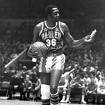 In this 1978 file photo Meadowlark Lemon of the Harlem Globetrotters offers a pretzel to a referee during a game at New York's Madison Square Garden.