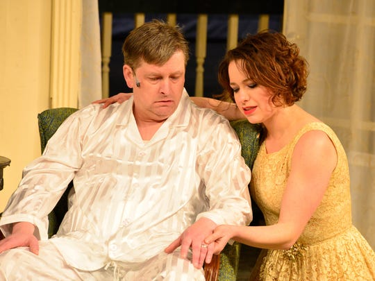 "Michael Roehl and Michelle Jorgensen, as Brick and Maggie, look on in STC's production of ""Cat on a Hot Tin Roof"" for its 83rd season."