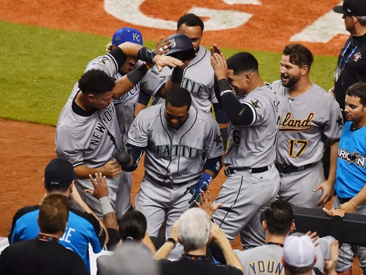 American League players celebrate Robinson Cano's home