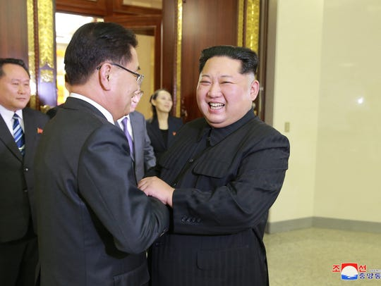 North Korean leader Kim Jong Un greets South Koreans