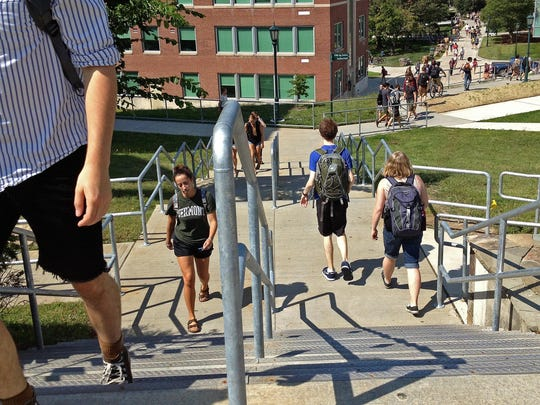 University of Vermont students walk through campus in this 2013 photo.
