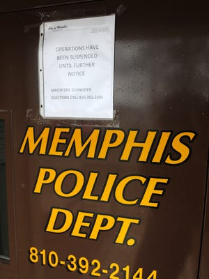 A message about the suspended operations is posted Monday, Feb. 22, on the door of the former Memphis Police Department.