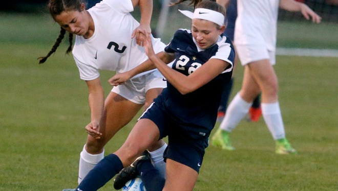 """Siegel's Emily Baker (22) and Houston's Abbie Rushwin (2) fight for the ball during a quarterfinal game of the TSSAA Class AAA Girls"""" Soccer Tournament, on Wednesday, Oct. 25, 2017, at the Richard Siegel Soccer Complex."""