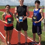 Marissa Perez, left, and Josiah Perez, right, pictured with Braden Grubb of Grayson at the ACEL State Track Meet. Marissa and Josiah Perez won two events each and Grubb won the shot put and discus.