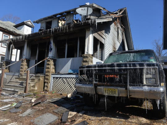 After a fire started late Saturday, a home on the 200